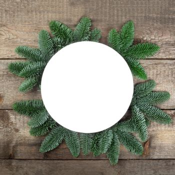 Christmas circle frame of natural fir tree branches with copy space for text
