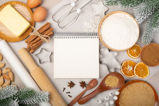 Christmas gingerbread cookies cooking background flat lay top view template with copy space for text. Baking utensils, spices and food ingredients