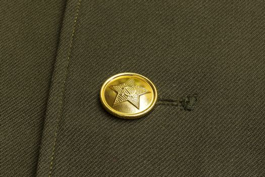 Button on the uniform of a soldier of the Soviet Army