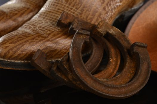 Closeup image of a full set of retro horse shoes for a small colt or a pony.