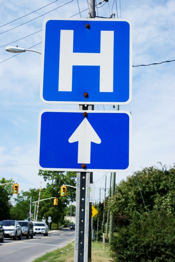 A Canadian hospital direction street sign used in traffic law and order.