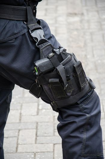 Leg of a policeman in which a firearm is found