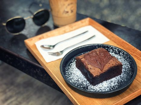 Dark chocolate brownies served with coffee
