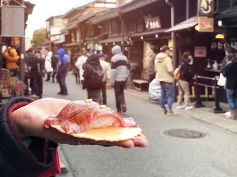 Japanese street food close-up Hida Beef Sushi and cracker at Takayama, Japan