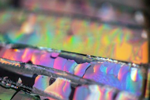A Broken CD Cut Up To Make Abstract Holographic Background