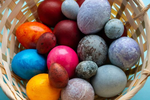 Basket with colorful Easter eggs.The Concept Of Easter.