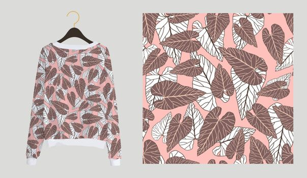 Trendy modern print for fabrics and textiles. Seamless tropical pattern. Palm leaves on a pink background