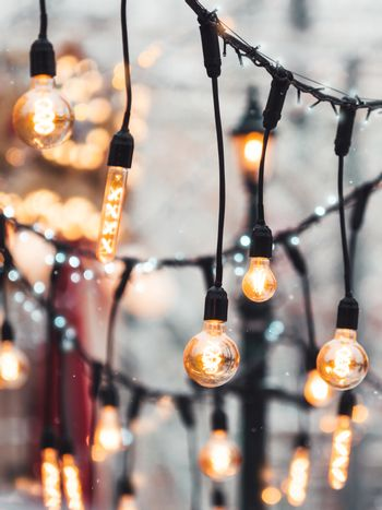 Vintage light bulbs with glow filament. Incandescent retro design. Outdoor decoration for New Year and Christmas celebration. Moscow, Russia.