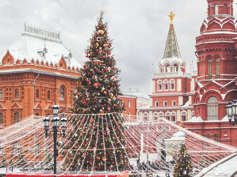 Christmas tree on Manezhnaya square near State Historical Museum. Street decorations for New Year celebration. Moscow, Russia.