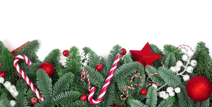 Christmas design boder frame greeting card of noble fir tree branches and baubles isolated on white background