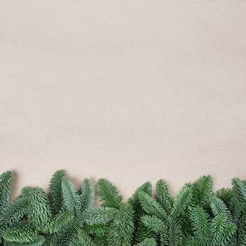 Traditional green christmas tree noble fir border frame on craft paper background copy space for text