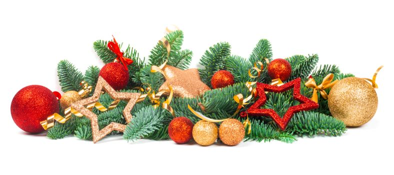 Christmas Border design element of fir tree branches and red and golden baubles and stars isolated on white background