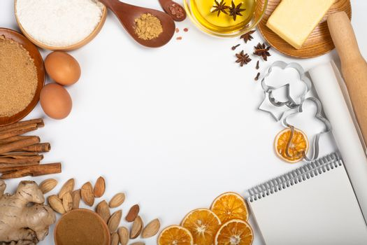 Christmas gingerbread cookies cooking background flat lay top view template with copy space for text. Baking utensils, spices and food ingredients border frame isolated on white background