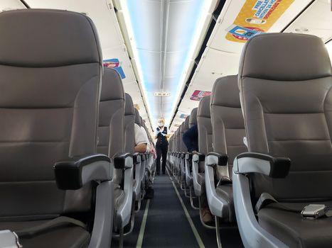 The interior of a deserted passenger compartment of a tourist bus Krakow, Poland - 05.15.2019