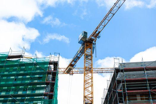 Construction site jib crane. Construction of new modern building