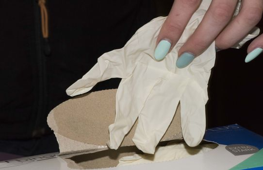 wearing latex gloves in case of danger of epidemics and diseases