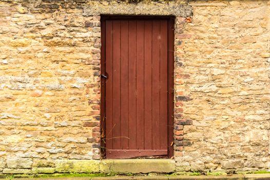 Old wooden door in the stone