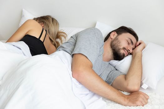 A Couple has problem and sleep by turn back to each other