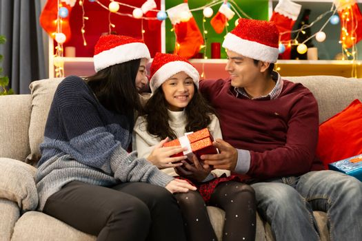 Happy family smile together in their home with decorated interior during Christmas