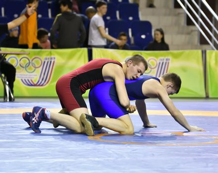 Orenburg, Russia - March 15-16, 2017: Young men compete in the sports wrestling at the Volga Federal District Championship in sports wrestling