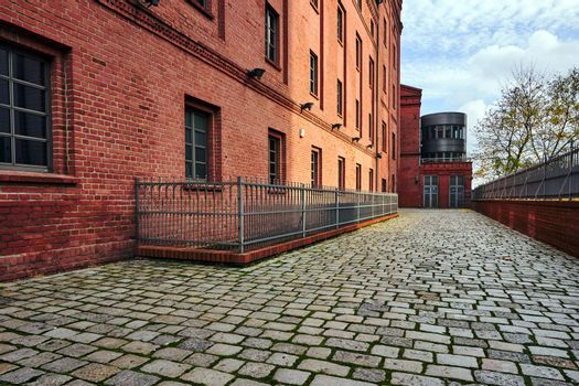 paved street and renovated buildings of an old brewery