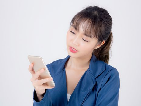 Beautiful portrait young business asian woman using smartphone isolated on white background, businesswoman looking and touch smart mobile phone on social media communication and technology concept.
