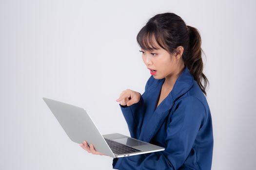 Beautiful portrait young asian business woman holding laptop com