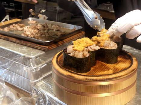 Street food process to cooking  beef sushi most popular delicious food in tsukiji fish market,  Japan