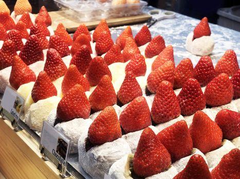 Street food strawberry Daifuku, Strawberry Mochi at Tsukiji Fish Market in Tokyo.