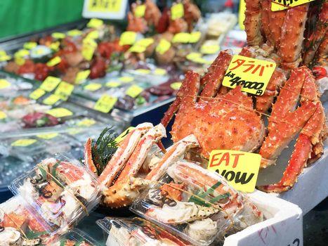 Giant fresh king crab seafood Street food in Tsukiji Fish Market, Japan.