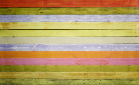 Colorful background image with a pattern of multi-colored horizontal stripes with an imitation of a painted wooden surface