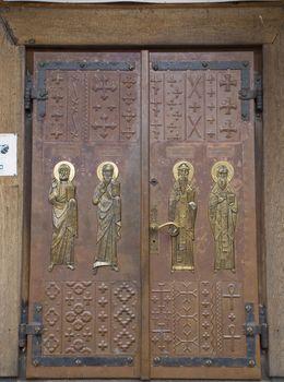 large wooden door with Orthodox religious symbols