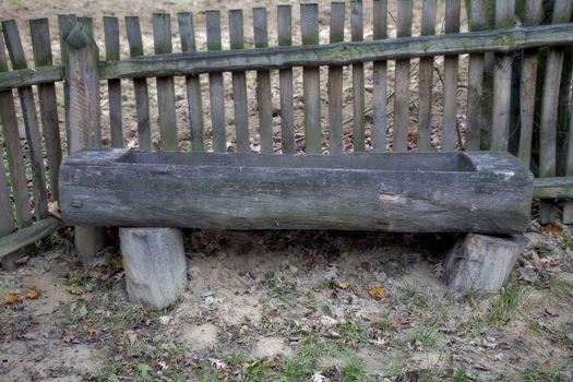 wooden animal feeding trough in the Polish countryside