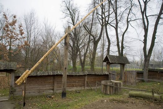 wooden well in an old village in Poland in Podlasie at the Muse