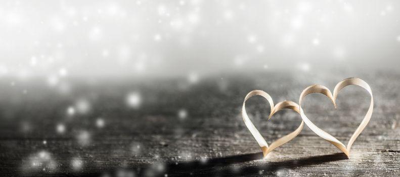 Golden ribbon hearts on wood