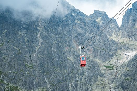 TATRANSKA LOMNICA, SLOVAKIA, AUGUST 2020 - Red cabin of cableway from Skalnate pleso to peak Lomnicky Stit in High Tatras mountains