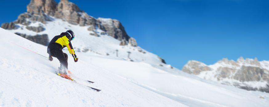 Skier in Dolomites Alps mountains