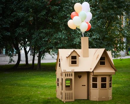 Cardboard playhouse in the backyard for kids. Eco concept