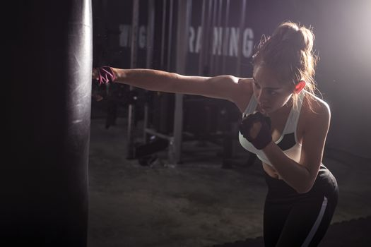 Fitness girl doing  boxing training in sport gym