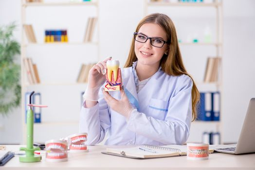 Dentistry student practicing skills in classroom