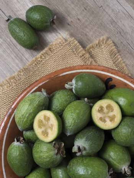 Fresh ripe sweet feijoa fruits. Healthy food background.