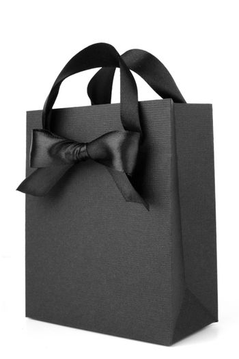 Black Friday paper bag with ribbon bow isolated on white background sale concept
