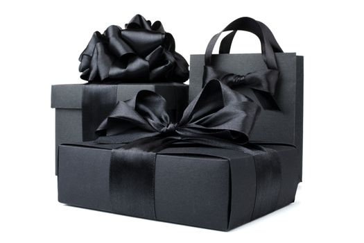 Concept sales, shopping, black friday. Paper shopping or gift bag box with silk ribbon bow isolated on white background