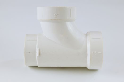 White polypropylene PVC polymer female pipe connector on a white background