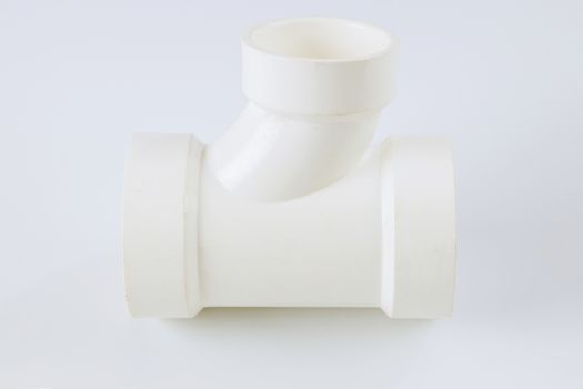 Plumbing waste water drain PVC connecting plastic pipes on a white background