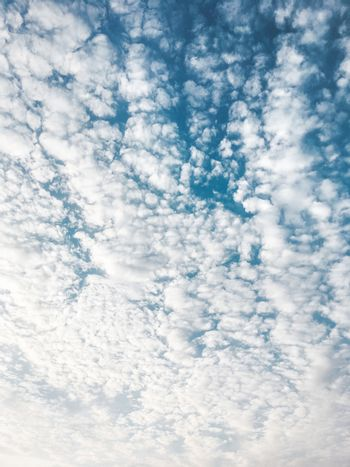 Cloudscape on blue sky. Outdoors abstract background with clouds.