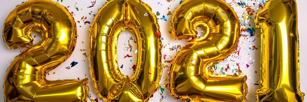 2021 new year concept from golden foil balloon and confetti