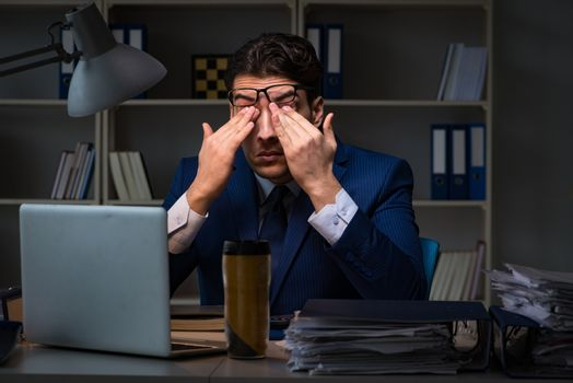 Businessman tired and sleeping in the office after overtime hours