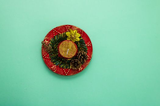 Decorated christmas red candle top view . Christmas composition with seasonal decorations and ornaments, colorful christmas background christmassy mood concept.