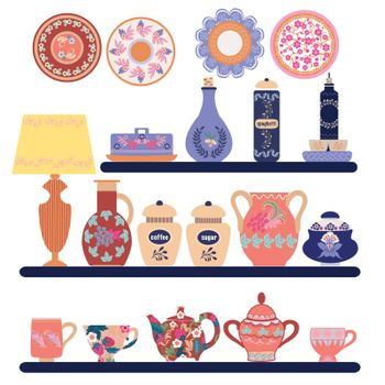 Collection of beautifully ceramic and porcelain household utensils and tools. Kitchen tableware on shelves. Decorative ceramic utensils and crockery plates, cups, dishes, bowls and pitcher.